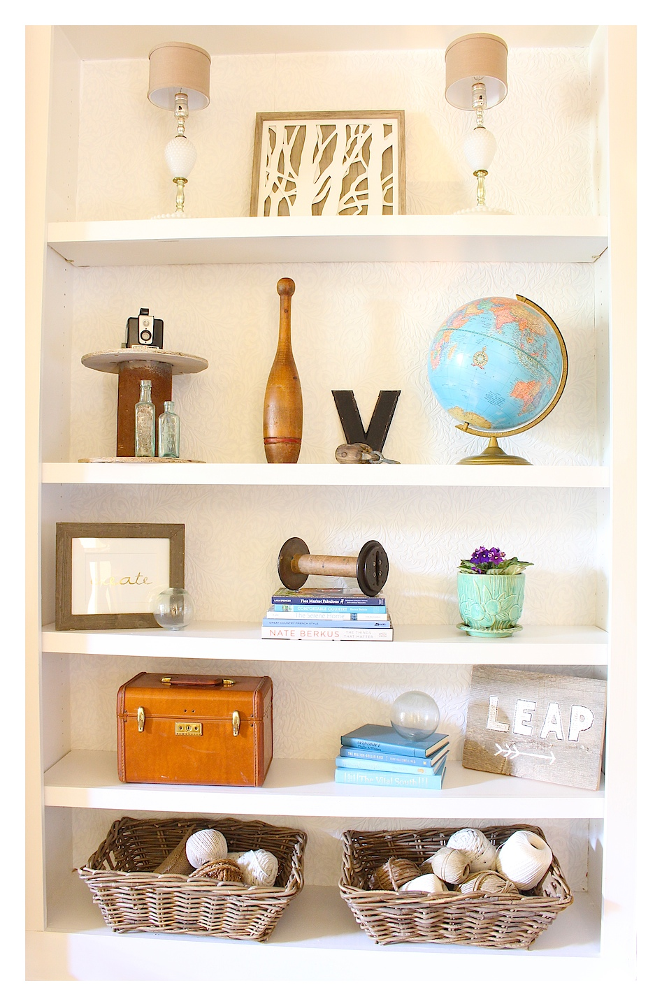 vintage decor in built-in bookcases