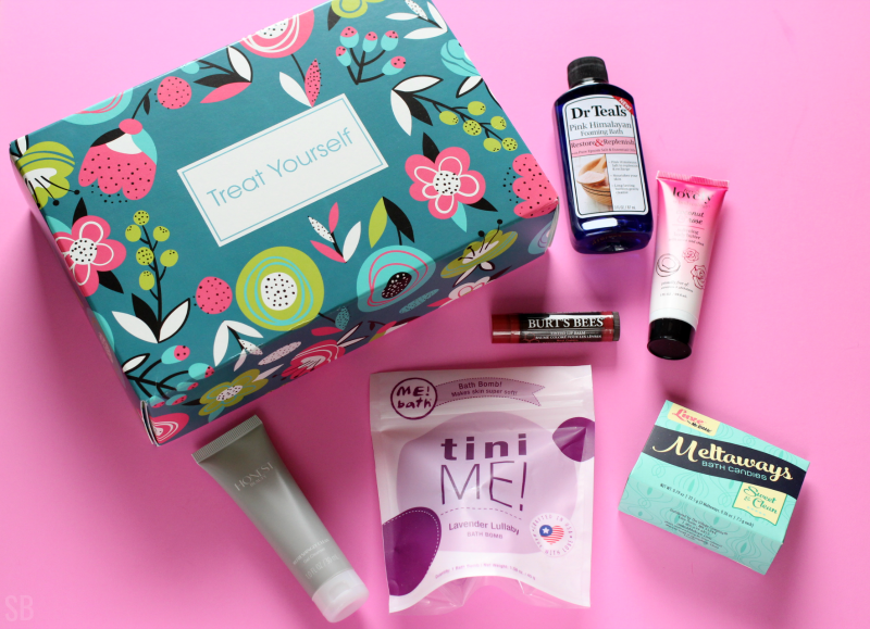 Treat Yourself Target Beauty Box contents on a pink table