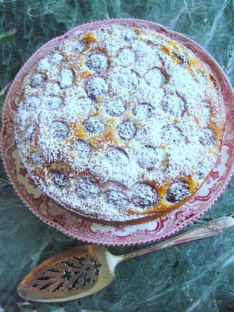 Southern Fresh Cherry Cake, quick and easy deliciously moist cake, made with self rising flour a touch of cornmeal, buttermilk, eggs, and butter.  Serve it plain with a dollop of whip cream or as we did with a dusting of powder sugar.