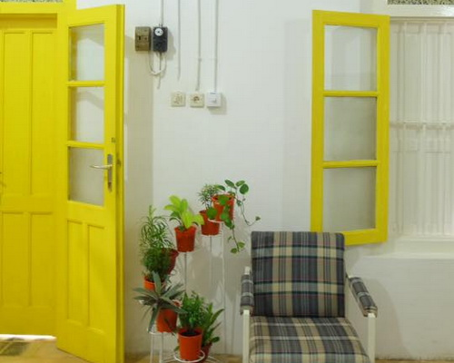 Tinuku Benetta House add yellow paint to unify impression pop into colonial architecture and classic-vintage interior
