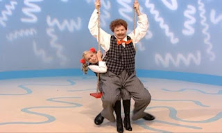 Mrs. Noodle gets on the swing. Mr. Noodle sits on Mrs. Noodle's lap. it's not taking turns. Sesame Street Elmo's World Friends The Noodle Family