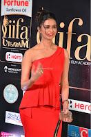 Meenakshi Dixit in Red One Shoulder Red Zipped up gown at IIFA Utsavam Award 09.JPG