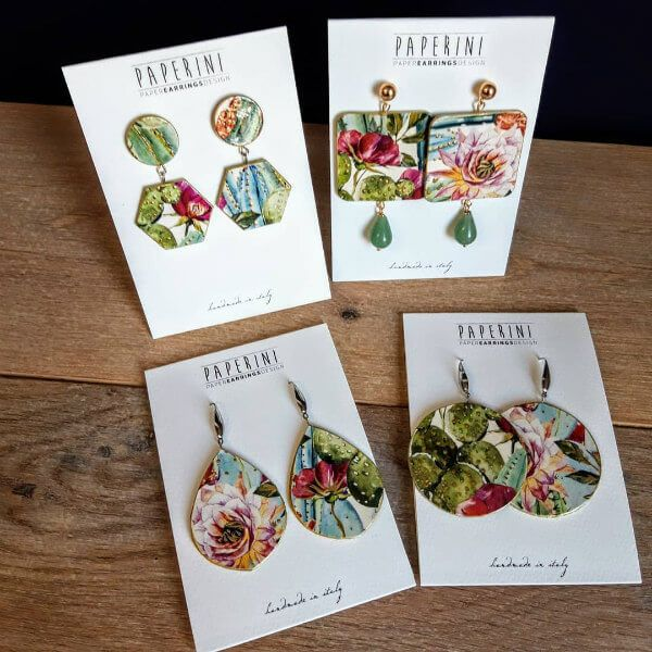 four pairs of floral paper earrings, each a different geometric shape