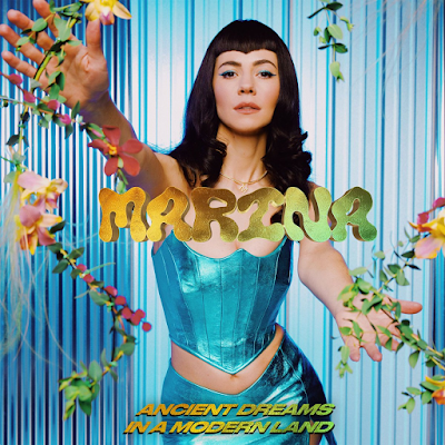 Allow Us To Reintroduce You To Authentic Superstar Songbird MARINA & Her Spectacular Sprightful Tune '- Ancient Dreams In A Modern Land'!