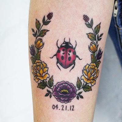 ladybug tattoo with date