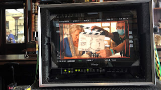 View through a TV film camera at a behind the scenes shot