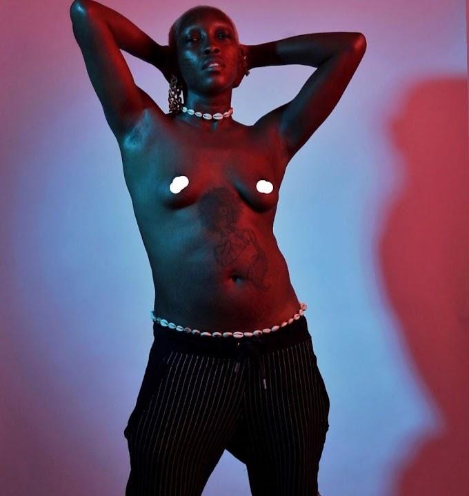 Tribal marks model, Adetutu OJ goes topless, braless