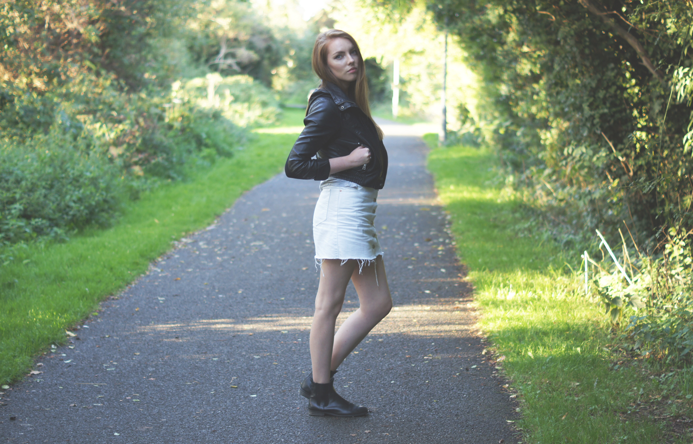 white denim skirt and leather jacket
