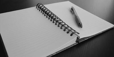 Open journal with a pen.