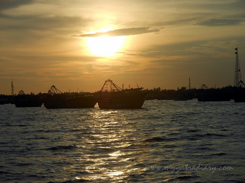 Sunset and boats during boat ride in Rameswaram, Tamil Nadu