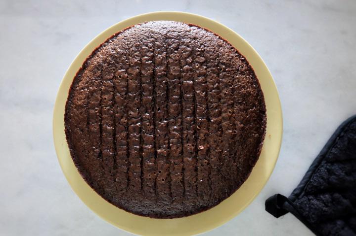 chocolate cake flipped onto plate