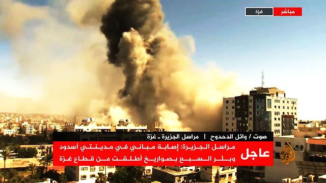 """فيديو مباشرلتدمير برج سكني بغزة...وكتائب """"القسام"""" تتوعد برد قاسي على تل أبيب"""