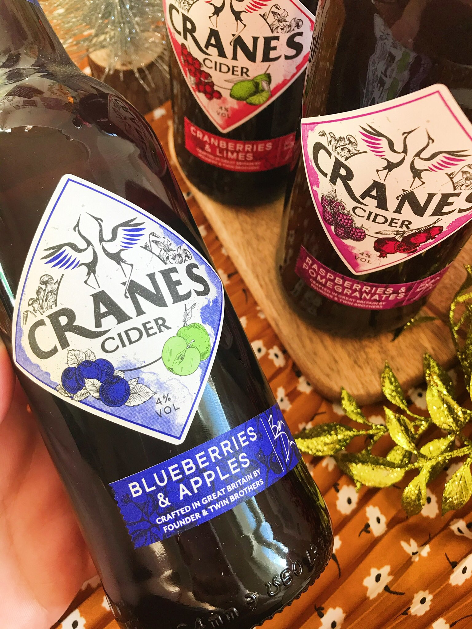 Cranes Cider bottle held up