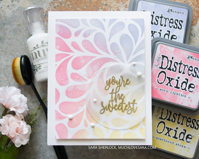 This pretty colorful design was created by ink blending through a Gina K Designs stencil.  For the full details, visit the blog post for this card.