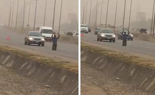 Video: Man seen praying on busy road in Lugbe, Abuja