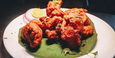 Garnished chicken fry in serving plate for chicken fry recipe
