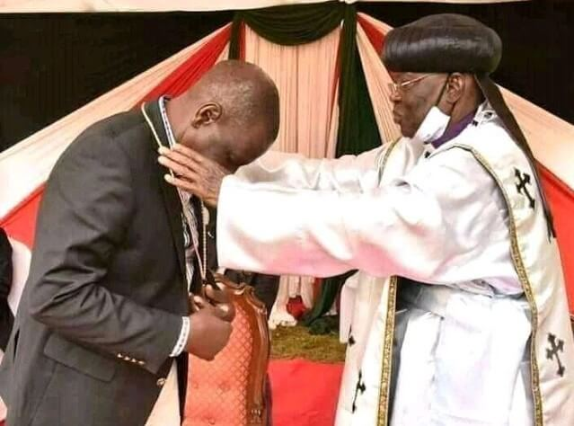 Deputy President William Ruto with Father John Pesa in Sugoi
