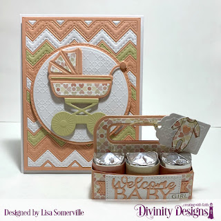 Divinity Designs Stamp/Die Duos: Baby Clothesline Custom Dies: Candy Carrier, Pierced Rectangles, Baby Blessings, Sentiment Strips, Clouds & Raindrops, Chevron Background, Circles, Double Stitched Circles, Baby Carriage, Large Banners Embossing Folder: Cross Stitch Paper Collection: Baby Girl
