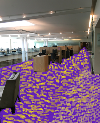 photo of library main floor with carpet altered to obnoxious purple & gold print