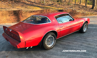 Rear angle of Mayan Red 1979 Firebird Esprit with 15x8 WS6 wheels.