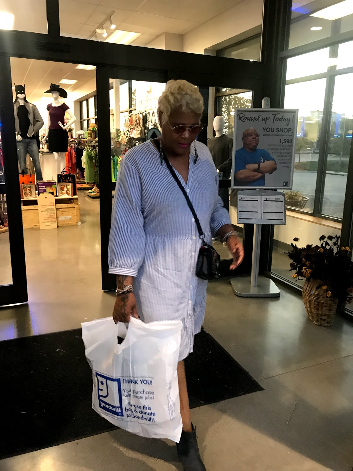 Image: Woman: Tangie Bell leaving the Goodwill Thrift store with all her under 4 dollar purchases. Not sponsored. Looking Good And Used: Everything Was 3.99: Pretty On A Penny