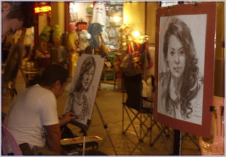 having portrait drawn at Asiatique night market