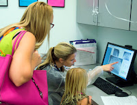 parent review x-rays with dental hygiene student.