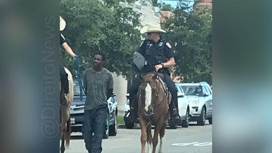 homem negro amarrado policiais indenizacao milhoes