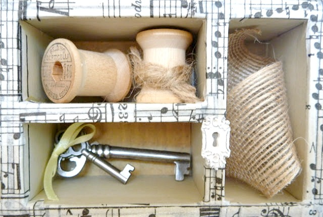 Tim Holtz Configurations Box Cubbies Filled with Ribbon Spools, Ribbon, and Keys
