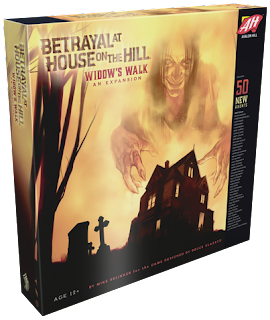 A display photo of the Widow's Walk box.The cover art shows a three-storey mansion in silhouette, with a pair of tombstones nearby, as a creepy old woman, perhaps a ghost or witch, looms over the mansion, grinning wickedly, as she reaches her hands down towards the mansion.
