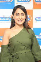 Pragya Jaiswal in a single Sleeves Off Shoulder Green Top Black Leggings promoting JJN Movie at Radio City 10.08.2017 124.JPG