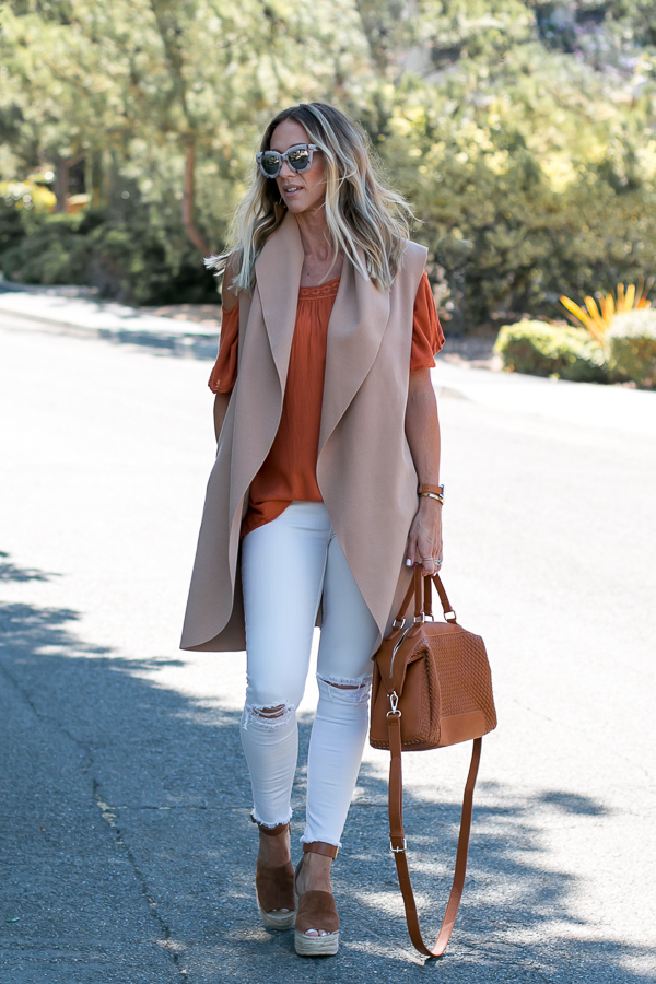 orange off shoulder top with vest
