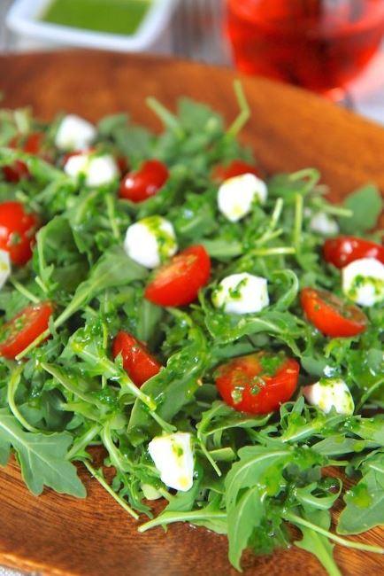 Arugula caprese salad with basil vinaigrette
