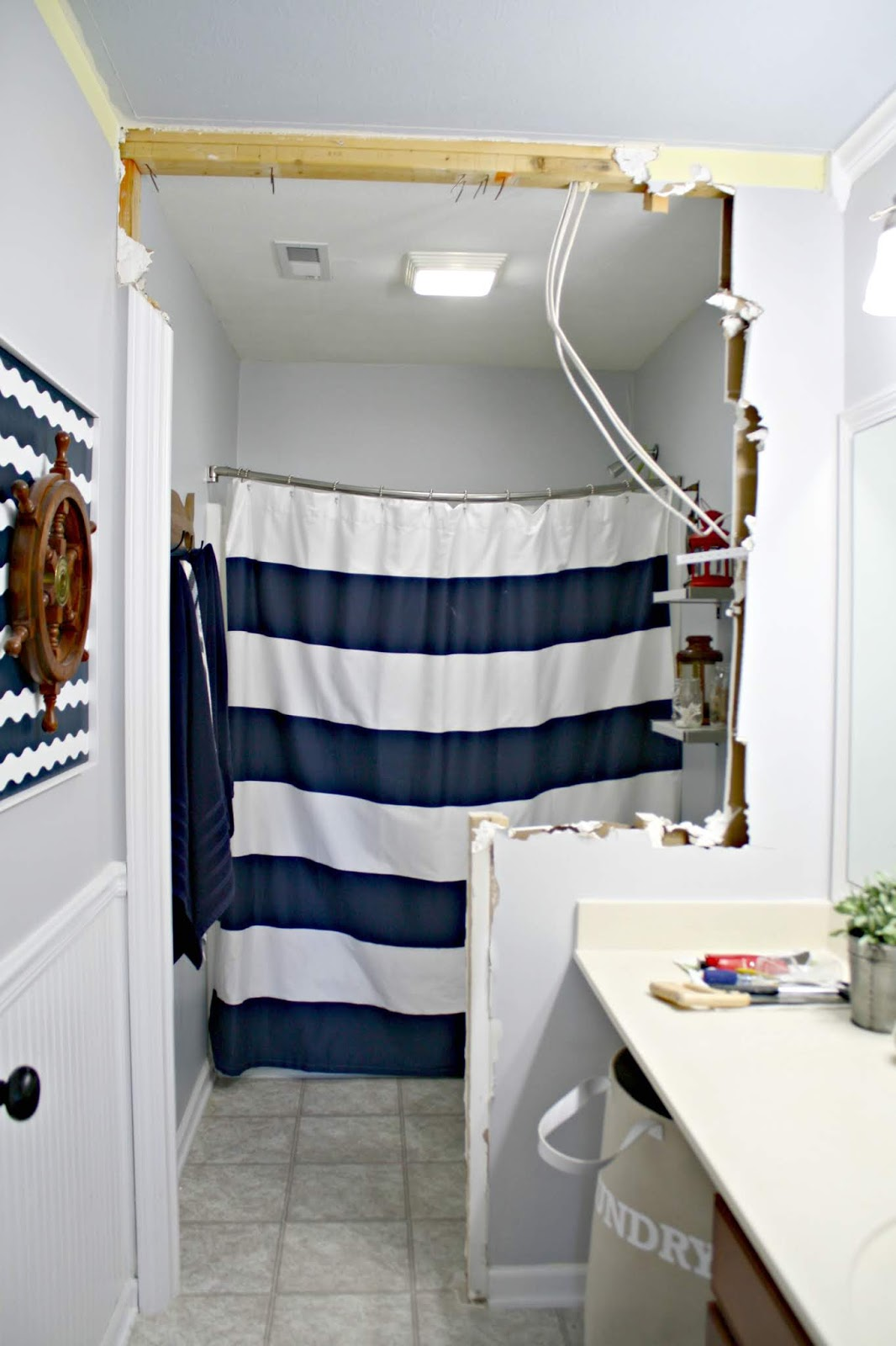 Raise up the shower curtain to make bathroom feel taller