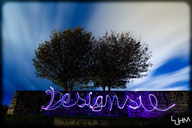 Aufschrift Designsie mit Licht gemalt