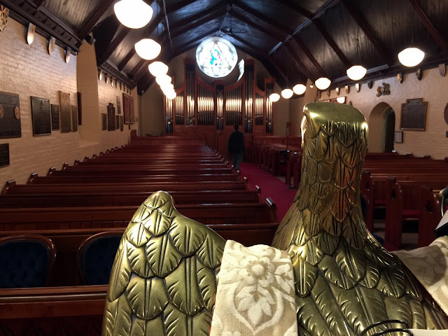 Glorious brass eagle overlooks St. Bart's interior