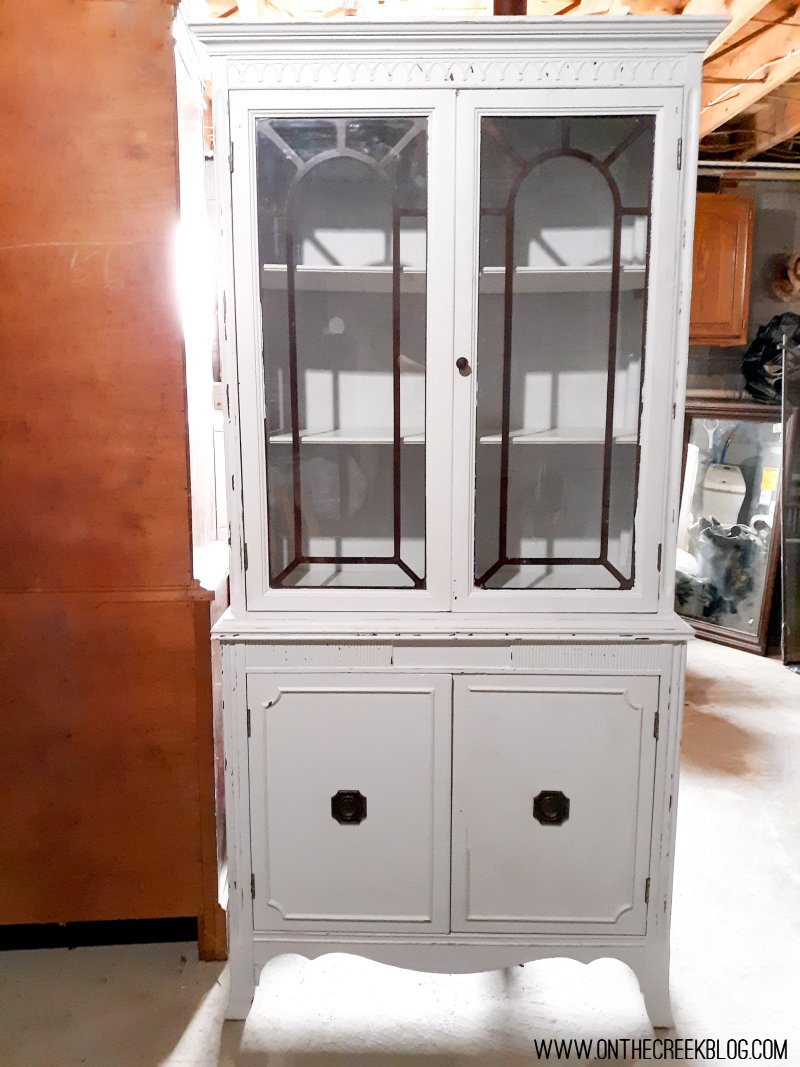 A makeover of a hutch from the Habitat For Humanity ReStore!  The hutch is painted in a chippy white with red accents!