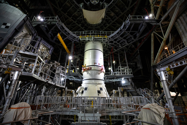 The aft segment of one of the Space Launch System's twin solid rocket boosters is placed atop the mobile launcher inside Kennedy Space Center's Vehicle Assembly Building in Florida.