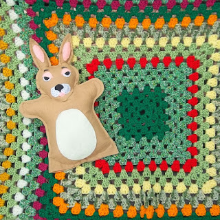 """Detail of """"Cottontail's Garden"""" afghan and lovey"""