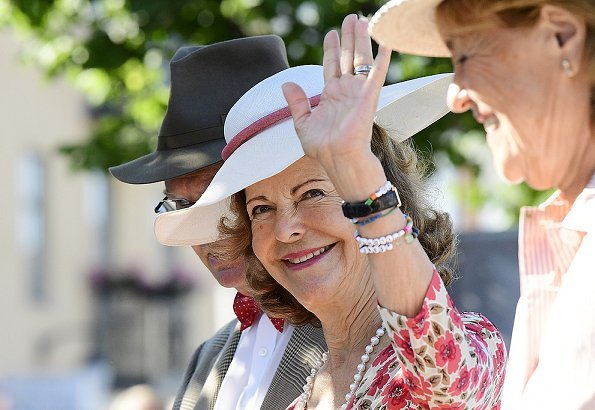 King Carl XVI Gustaf and Queen Silvia of Sweden took part in the King's Rally on the island of Öland. floral print summer dress