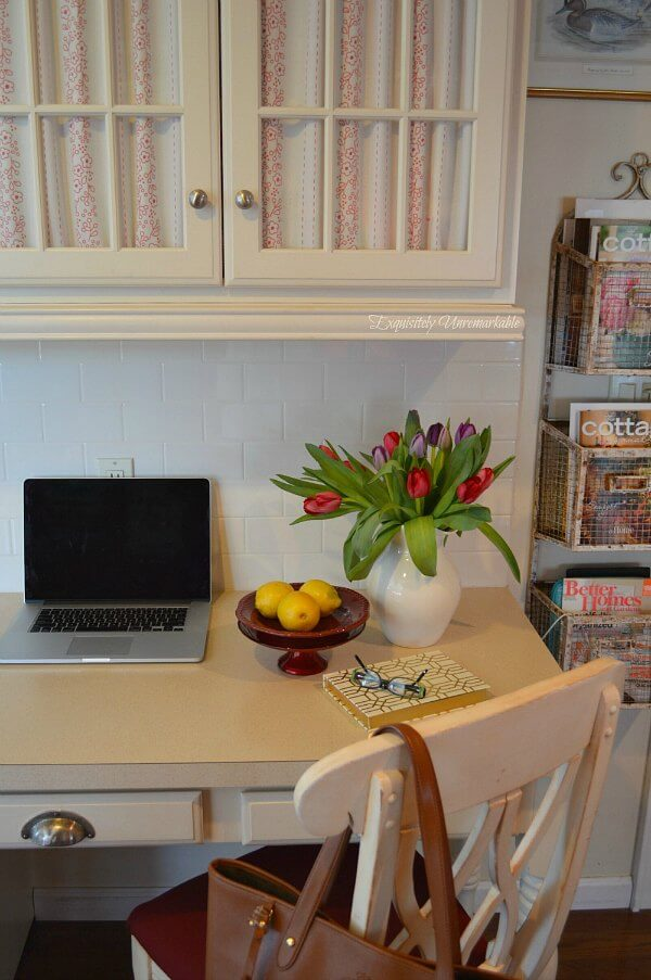 Cottage Kitchen Desk area with fabric covered cabinets and upholstered desk chair