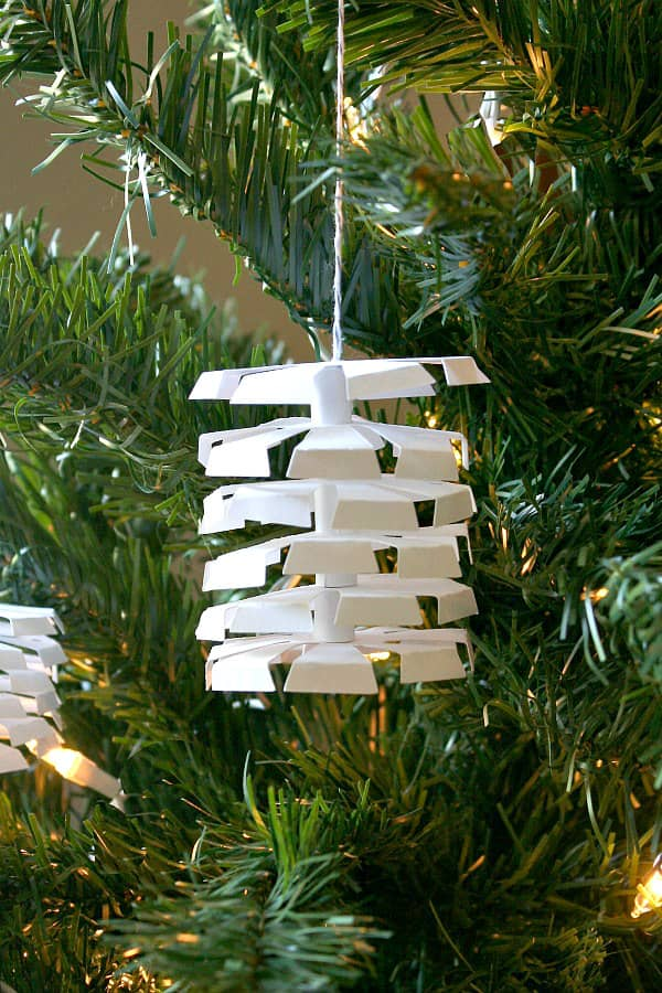 white paper ornament composed of six layered folded discs
