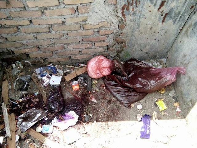 Pewarna  ada di dalam tempat pembuangan sampah Sementara di jalan DI. Panjaitan