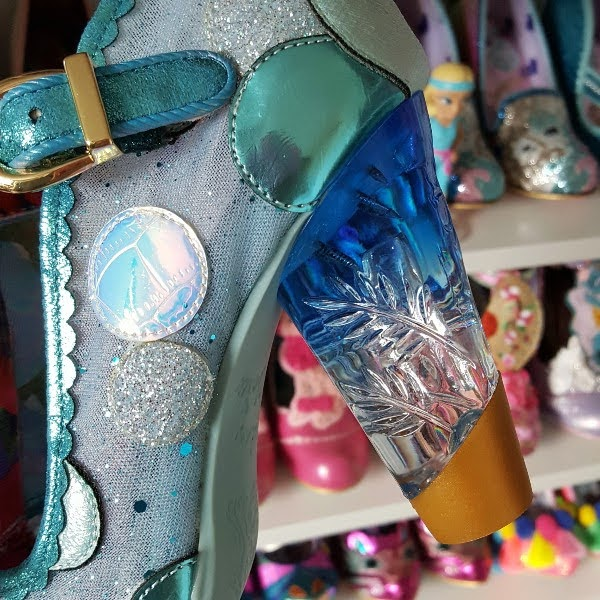 close up of blue gradient perspex lucite heel on shoe