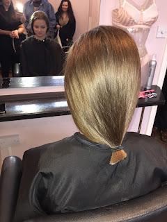 Ellie Bate has her hair cut for charity