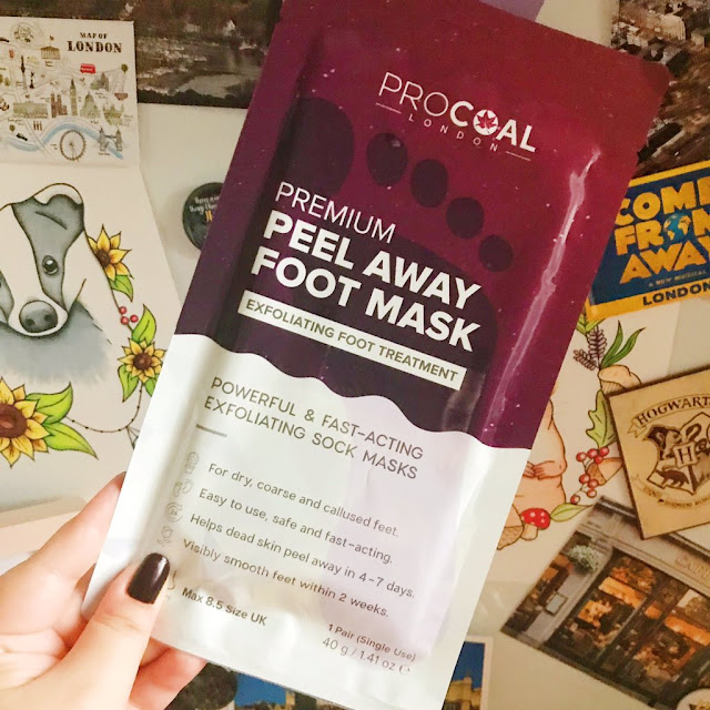 procoal foot mask held up in front of desk