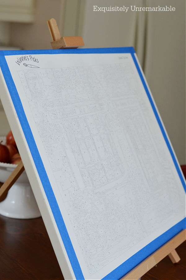 Small Wooden Tabletop Easel on a table with a canvas on it