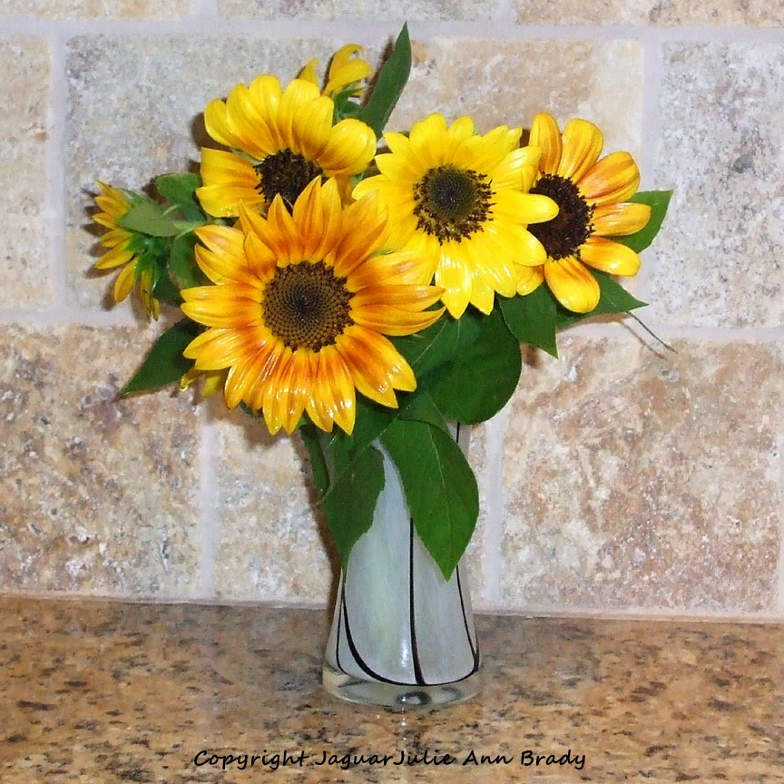 Sunflowers in a Decorative Glass Vase