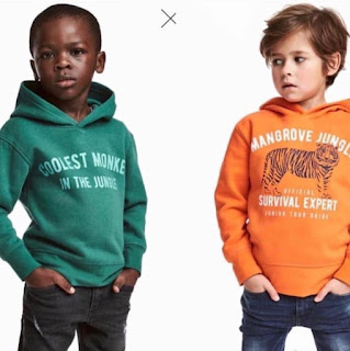 Black child model wearing H&M collest monkey in the jungle hoodie