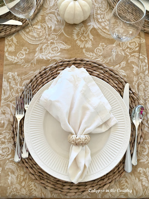 Simple Fall Place Setting with White Napkins and Rattan Chargers